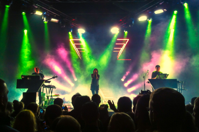 Chvrches live on stage.
